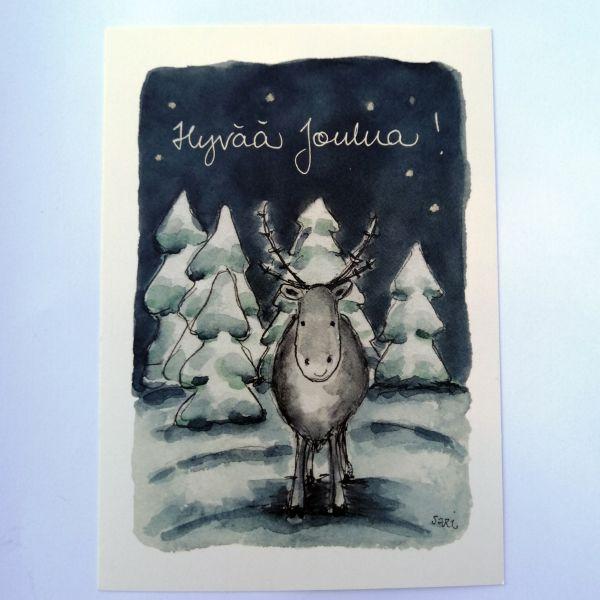 Sari´s ArtWork joulukortti, jossa hirvi lumisessa metsässä ja teksti Hyvää Joulua.