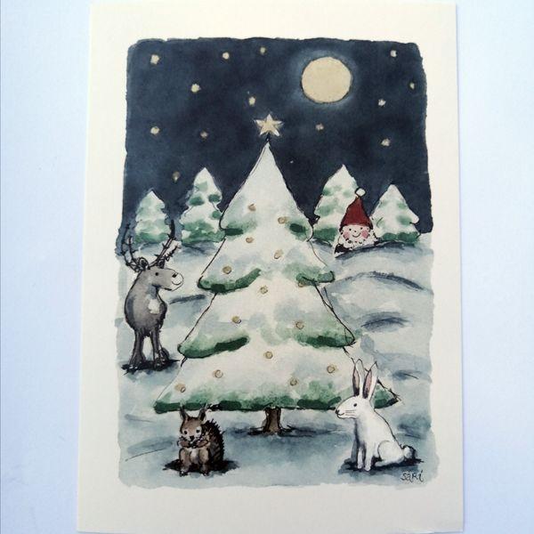 Sari´s ArtWork joulukortti, jossa lumisessa metsässä eläimiä