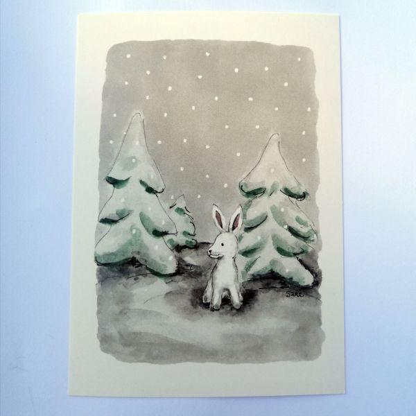 Sari´s ArtWork joulukortti, jossa valkoinen jänis lumisessa metsässä