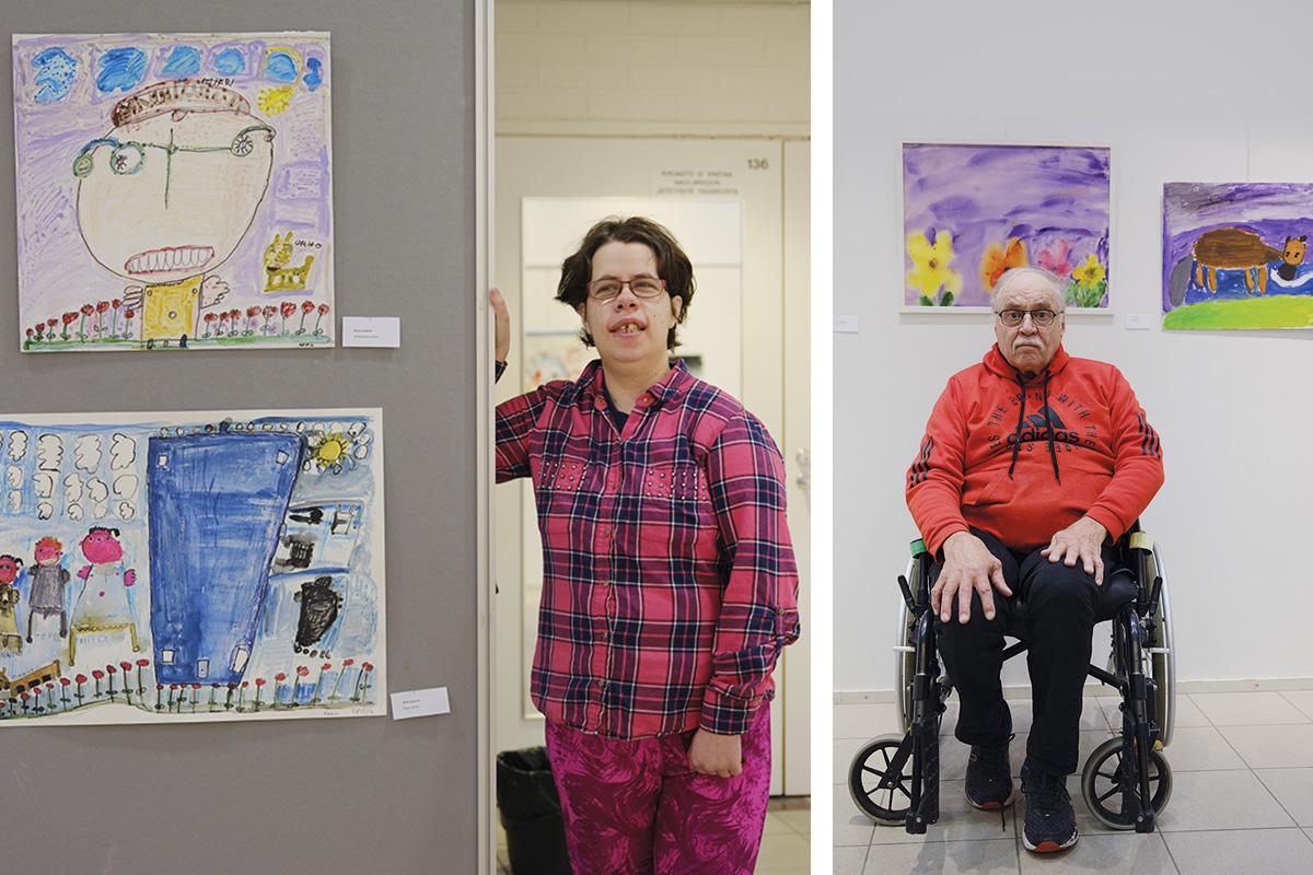 Kaksi taiteenharrastajaa näyttelyssä.